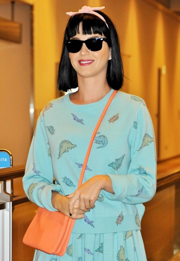 Katy Perry stretched the cutesy boundaries further by accessorizing with a pink headband, a pair of blush-toned Mary Jane platforms and an orange crossbody bag