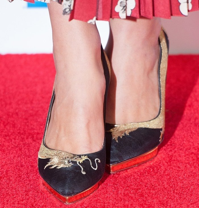 Keira Knightley's pretty feet in Auspicious Debbie Dragon pumps featuring golden dragon embroidery