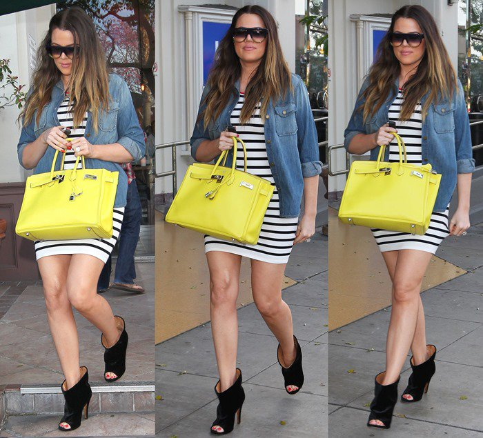 Layer a denim shirt over a striped dress like Khloe Kardashian