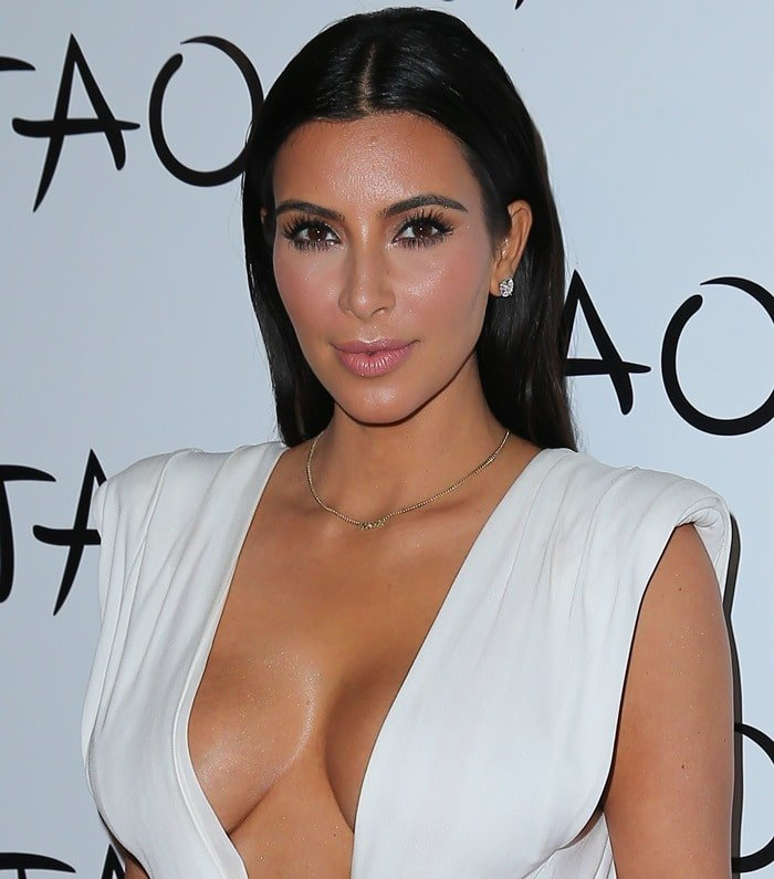 No one was surprised to see Kim in a white wrap dress that barely covered her most infamous assets
