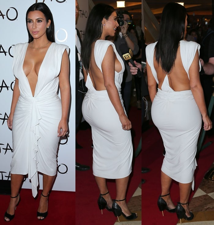 Kim styled the backless dress with the same Givenchy sandals that we spotted on her in Paris last month.