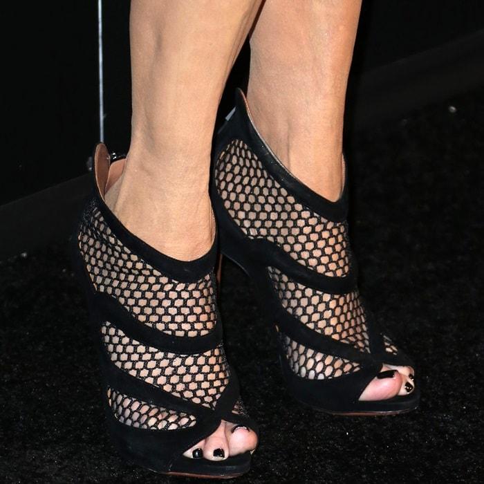 Kris Jenner's feet in mesh booties