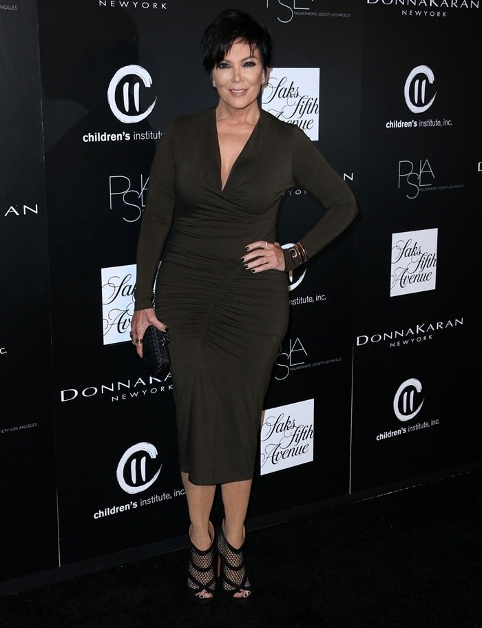 Kris Jenner in a moss green Donna Karan dress atthePSLA Autumn Party