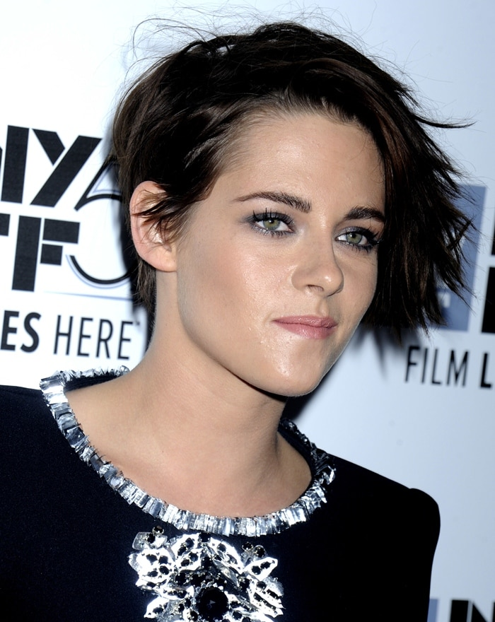 Kristen Stewart's edgy dress features monochromatic floral embroideries and aluminum details on the neckline