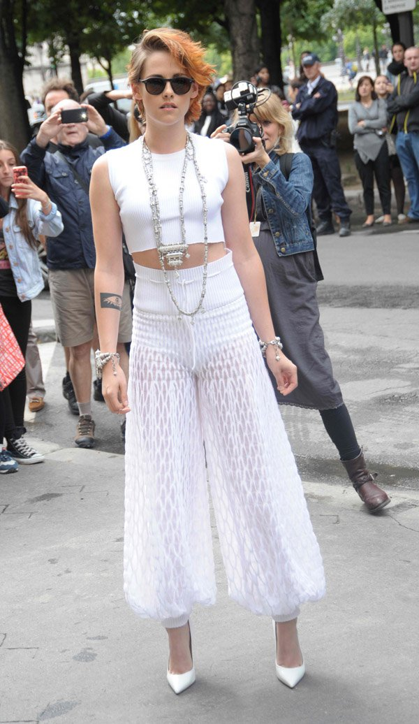 Kristen Stewart wears high-waisted Chanel pants at the Chanel Catwalk Show in France on July 8, 2014