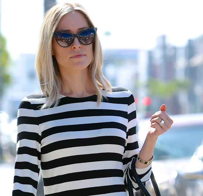 Kristin Cavallari returning to her car after shopping at Melrose place on October 23, 2014