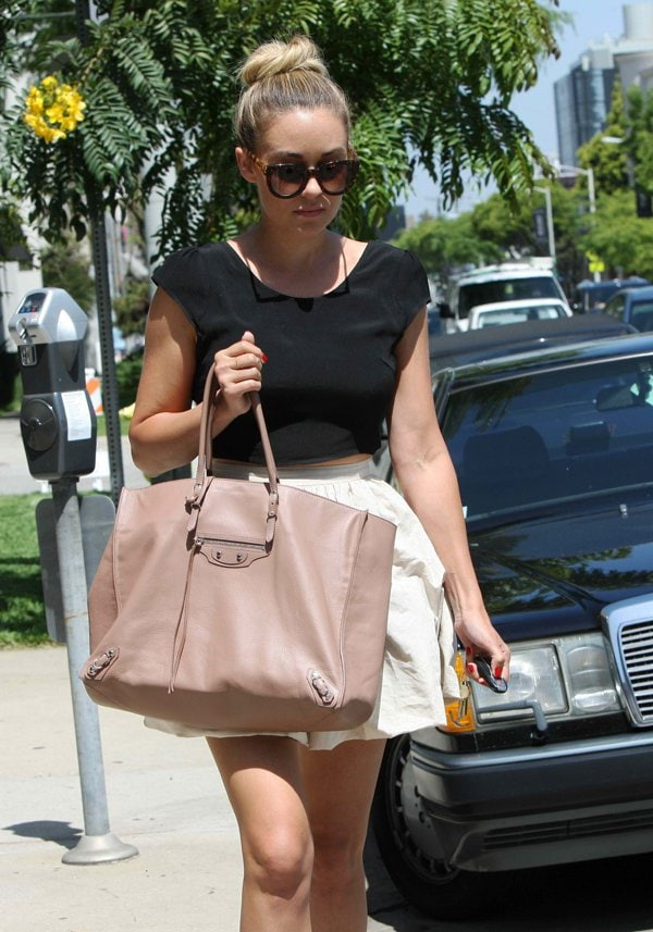 Lauren Conrad styled her Pins and Needles tie-back cap-sleeve blouse with a high-waisted Paper Crown skirt