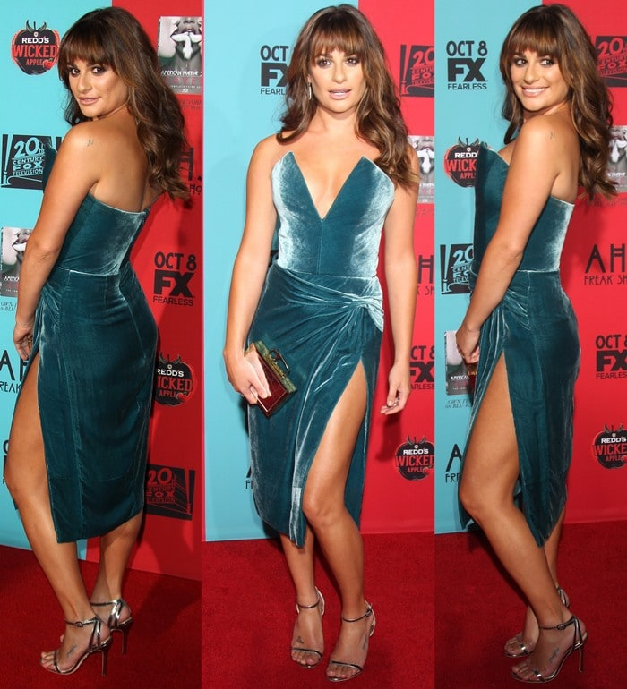 Lea Michele donned a strapless velvet dress by Cushnie et Ochs featuring cutout detailing, a plunging neckline, and a thigh-high slit