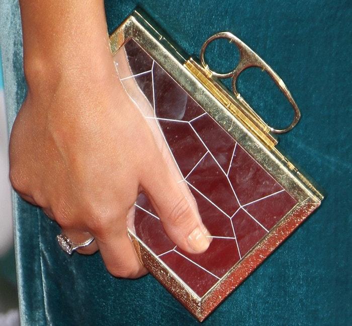 Lea Michele toting a gold box clutch