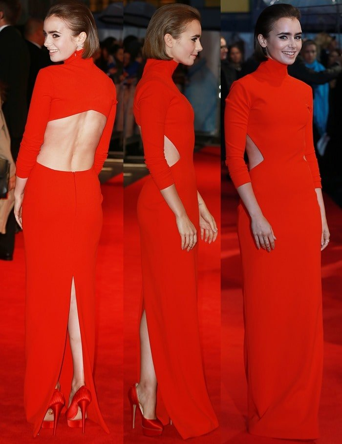 Lily Collins ina bright red high-neck long-sleeved dress from the Solace London Fall 2014 collection