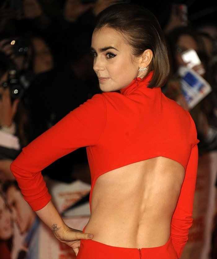 Lily Collins wearing an open back dress at the premiere of her film 'Love, Rosie'