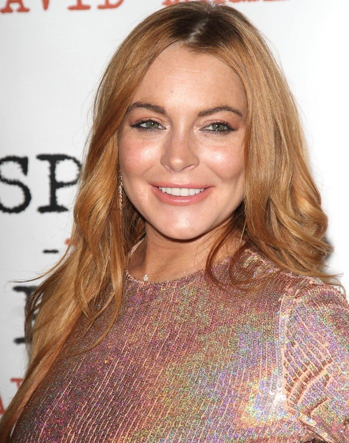 Lindsay Lohan ina form-fitting silver sequined dress by Givenchy