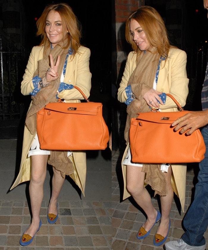 Lindsay Lohan arriving at Chiltern Firehouse in Marylebone, England, on September 28, 2014