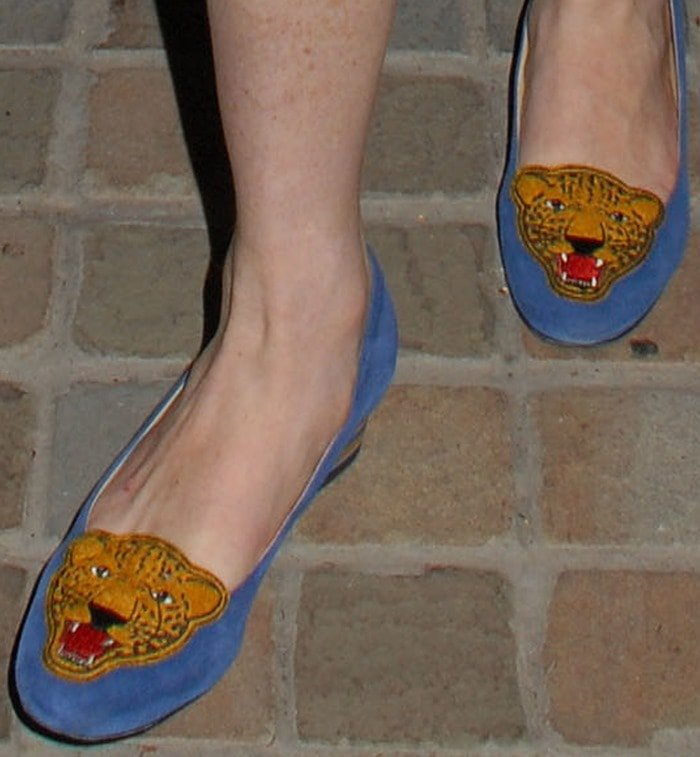 Lindsay Lohan's blue mascot-embroidered suede pumps