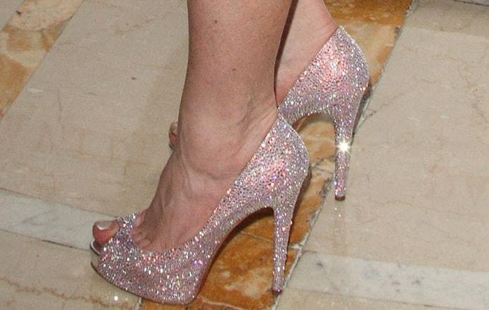 Lindsay Lohan's feet in glittering Christian Louboutin peep-toe pumps