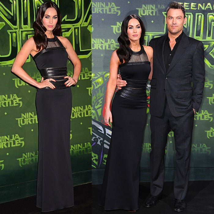 Megan Fox posing on the black carpet with husband Brian Austin Green