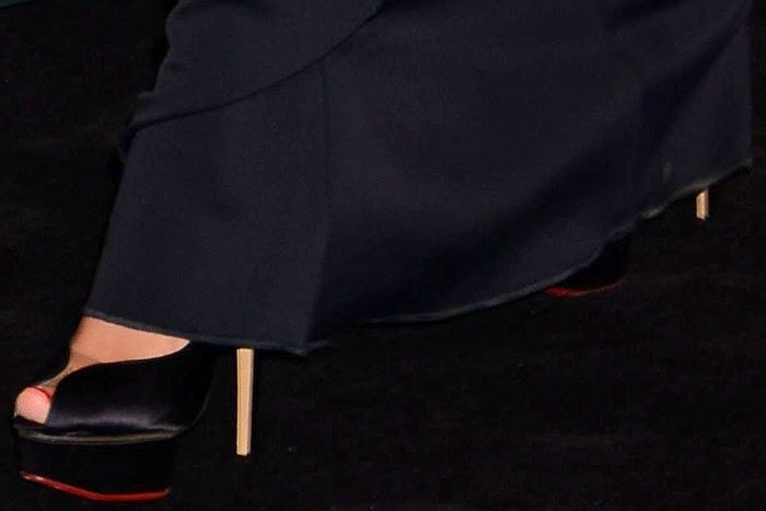"Charlotte Olympia ""Daphne"" platform pumps peeking out from under the hem of Megan Fox's David Koma dress"