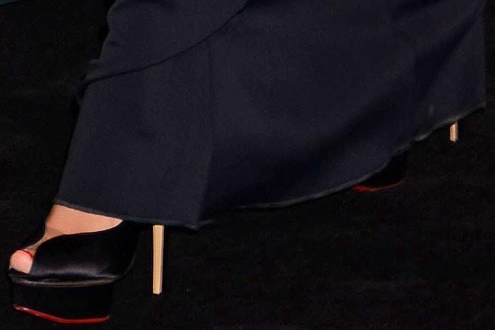 "Charlotte Olympia ""Daphne"" platform pumps peeking out from under the hem of Megan Fox's David Komadress"