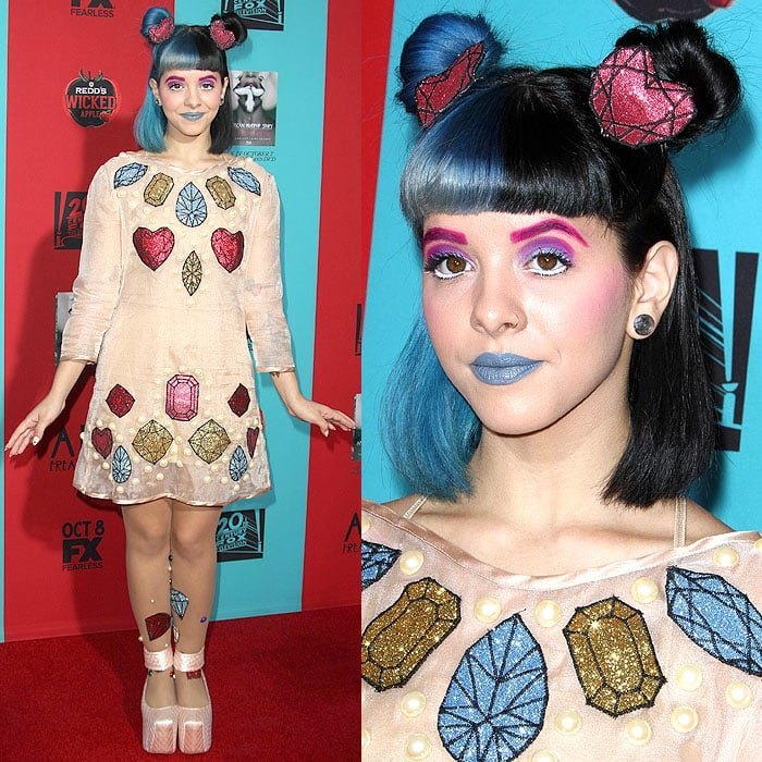 Singer Melanie Martinez posing on the red carpet at the American Horror Story: Freak Show premiere