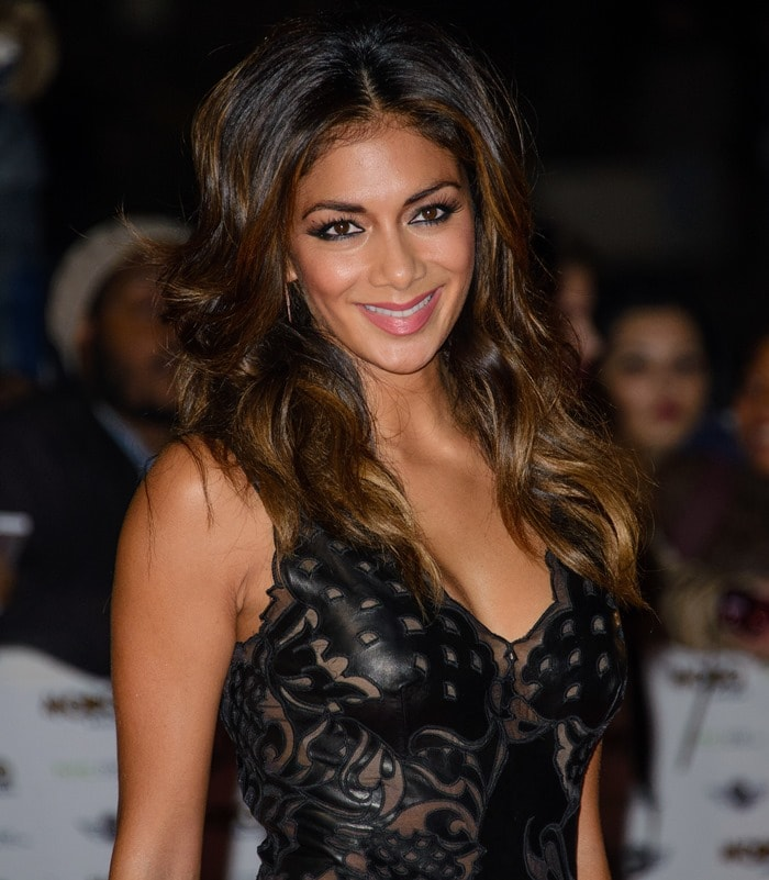 Nicole Scherzinger in a skin-tight faux leather dress by Ermanno Scervino