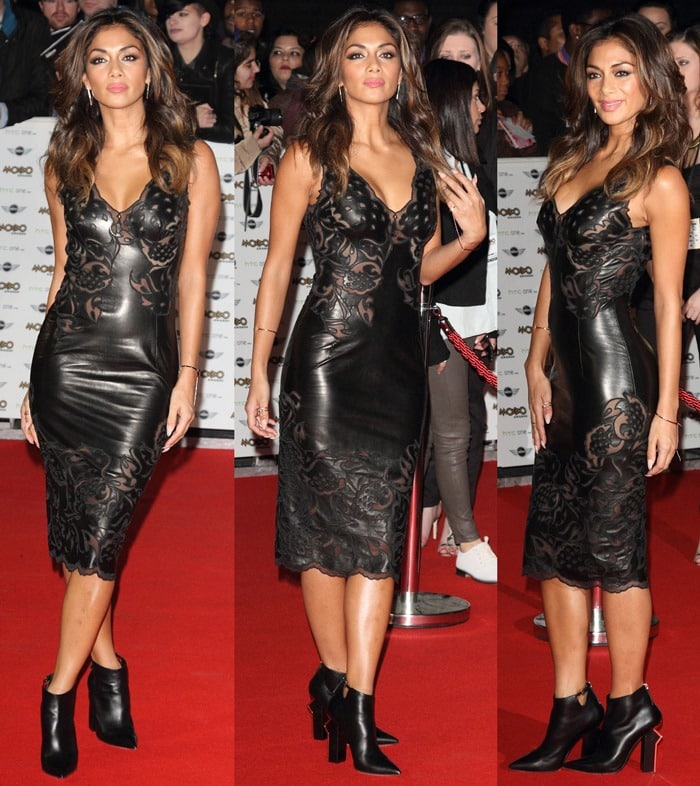 Nicole Scherzinger's dress features a plunging V-neck and sheer panels