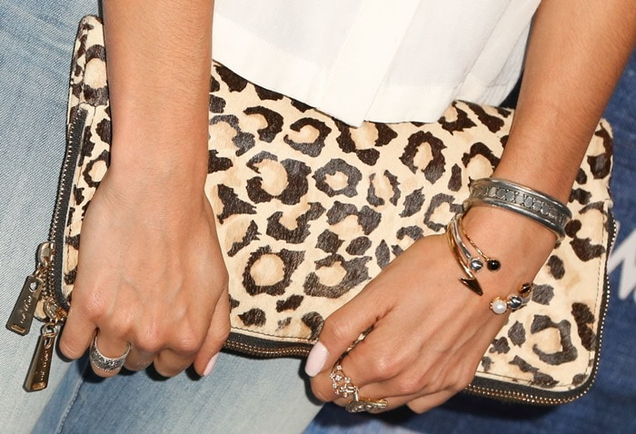 Nikki Reed's leopard-print zippered fold-over clutch