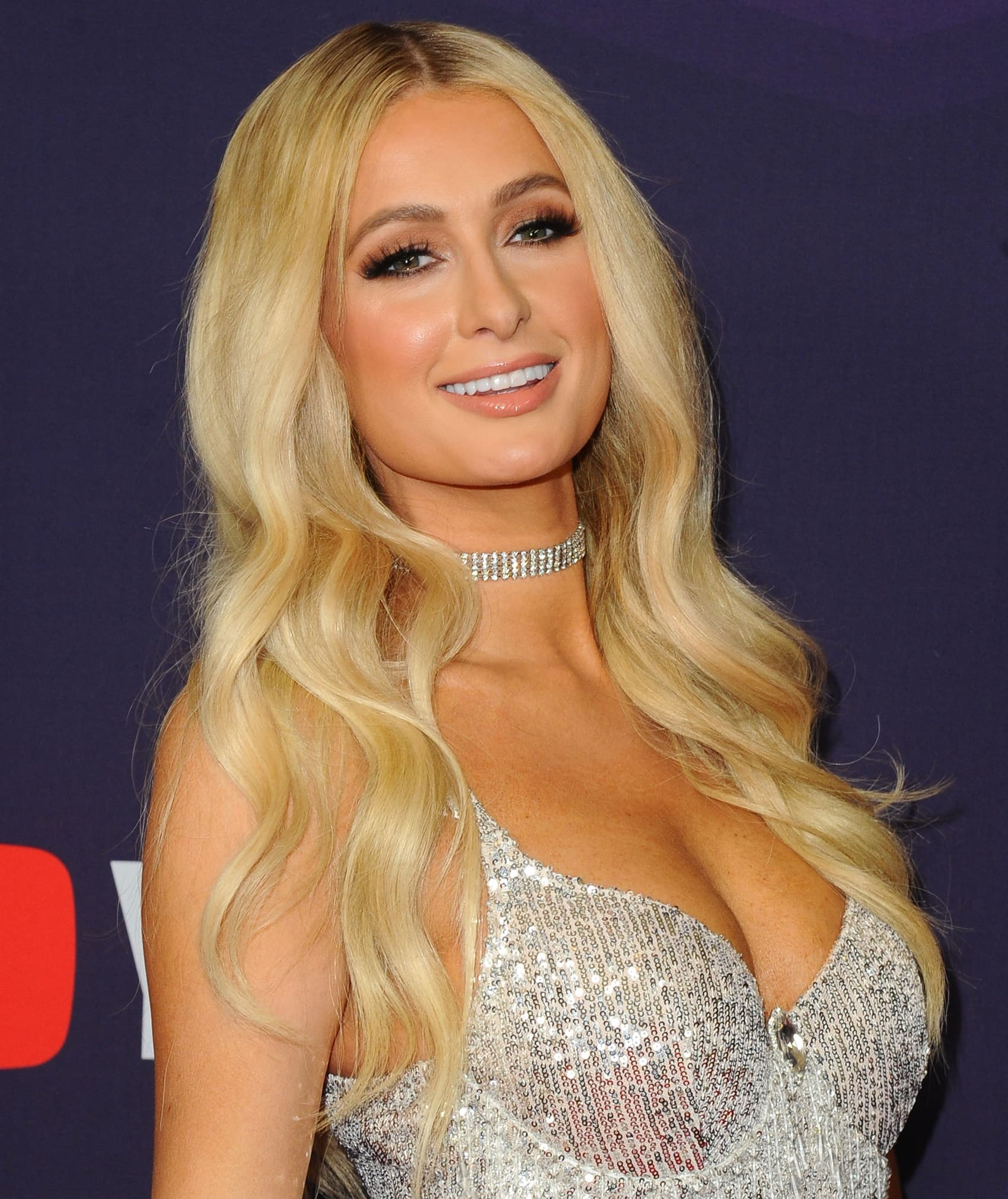 Paris Hilton claims her boobs are real and is glad she never got a boob job