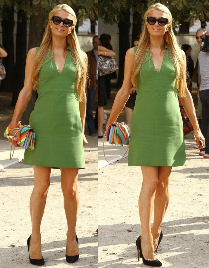 Paris Hilton in a green sleeveless mini dress by Valentino