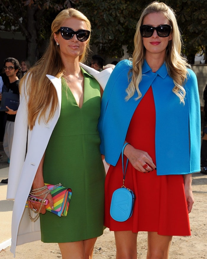 Paris Hilton toted a multicolored striped clutch and sported oversized sunglasses
