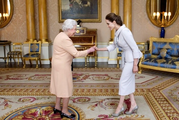 Angelina Jolie bowed to Queen Elizabeth II in the 1844 Room at Buckingham Palace on Friday morning in London