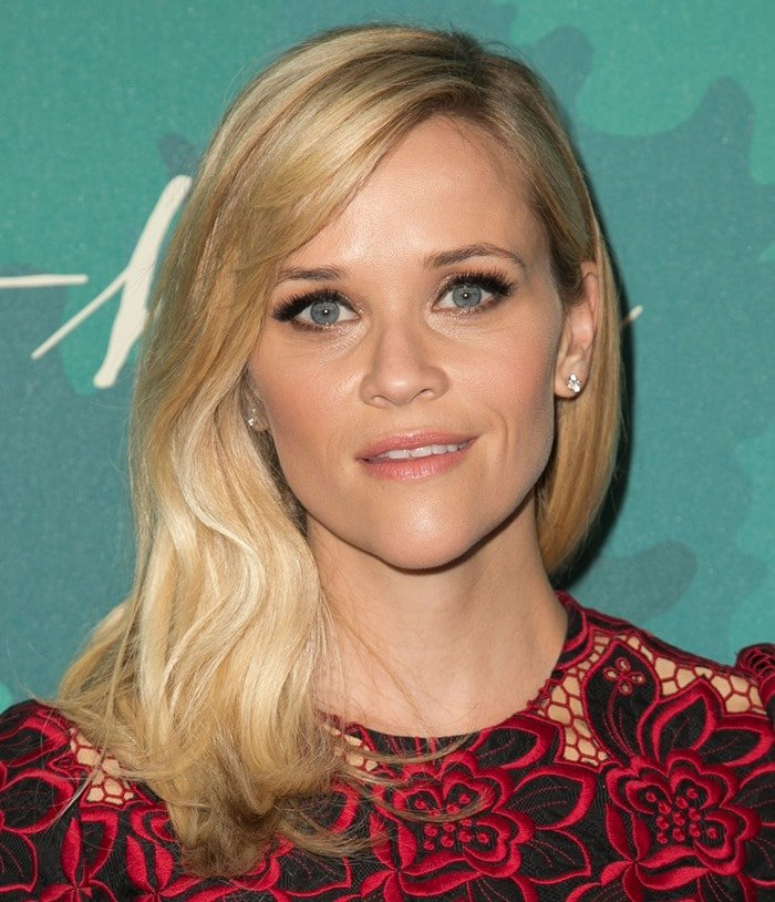 Reese Witherspoon in a black-and-red floral-embroidered lace dress from Dolce & Gabbana