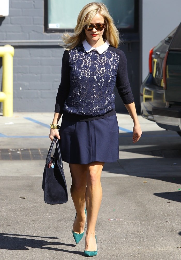 """Reese Witherspoon totedleather-and-suede """"Riley"""" tote by Jimmy Choo and accessorized with two gold bracelets and a pair of sunglasses"""