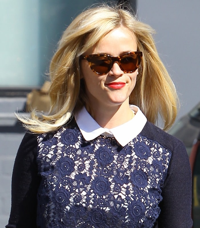 """Reese Witherspoon wearing a flowery """"Sandy"""" crewneck sweater by Tory Burch while visiting a hair salon in Beverly Hills"""