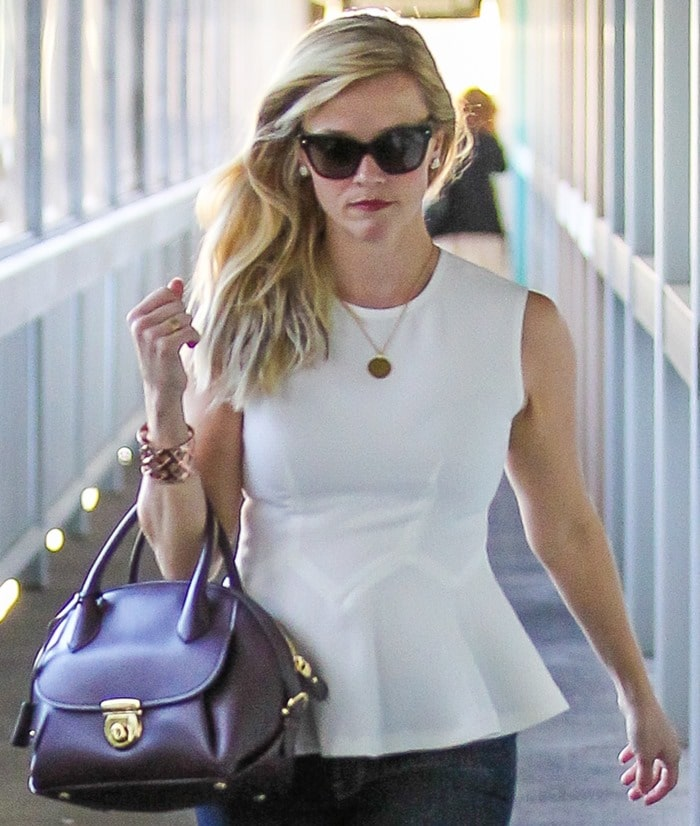 "Reese Witherspoon toting a plum-colored ""Fiamma Domed"" satchel bag by Salvatore Ferragamo"