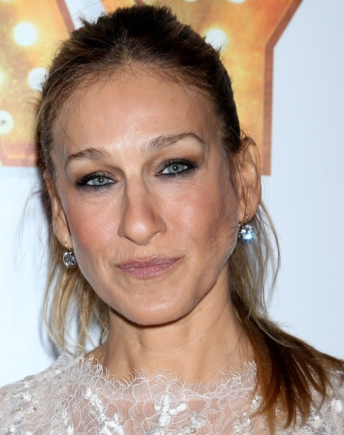 Sarah Jessica Parker showing off her diamond earrings
