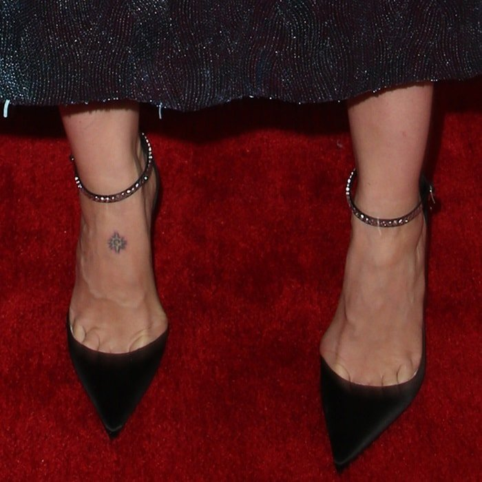 Sarah Paulson's starburst design foot tattoo