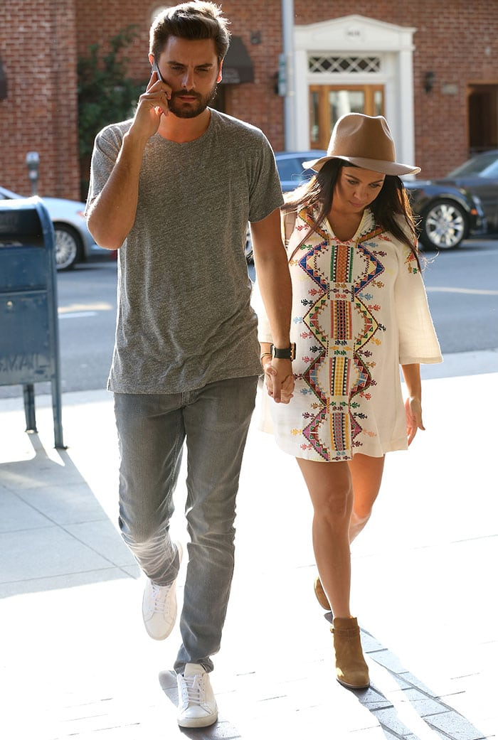 Kourtney Kardashian completed her boho look with Wyatt ankle boots, a fedora, and a backpack by Proenza Schouler