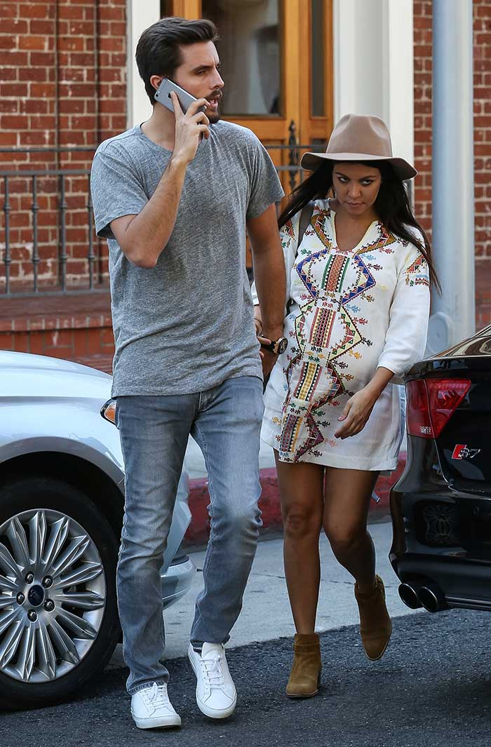 Pregnant reality star Kourtney Kardashian wearing a smock dress by Kate Moss for Topshop