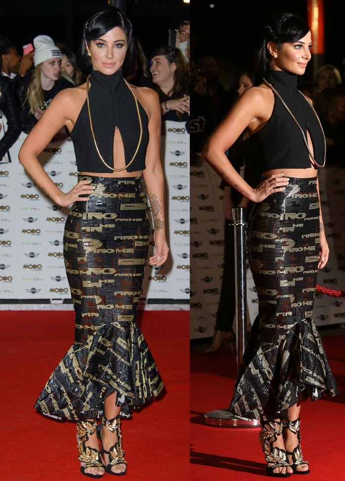 Tulisa Contostavlos in a knee-length fitted skirt paired with a daring black crop top
