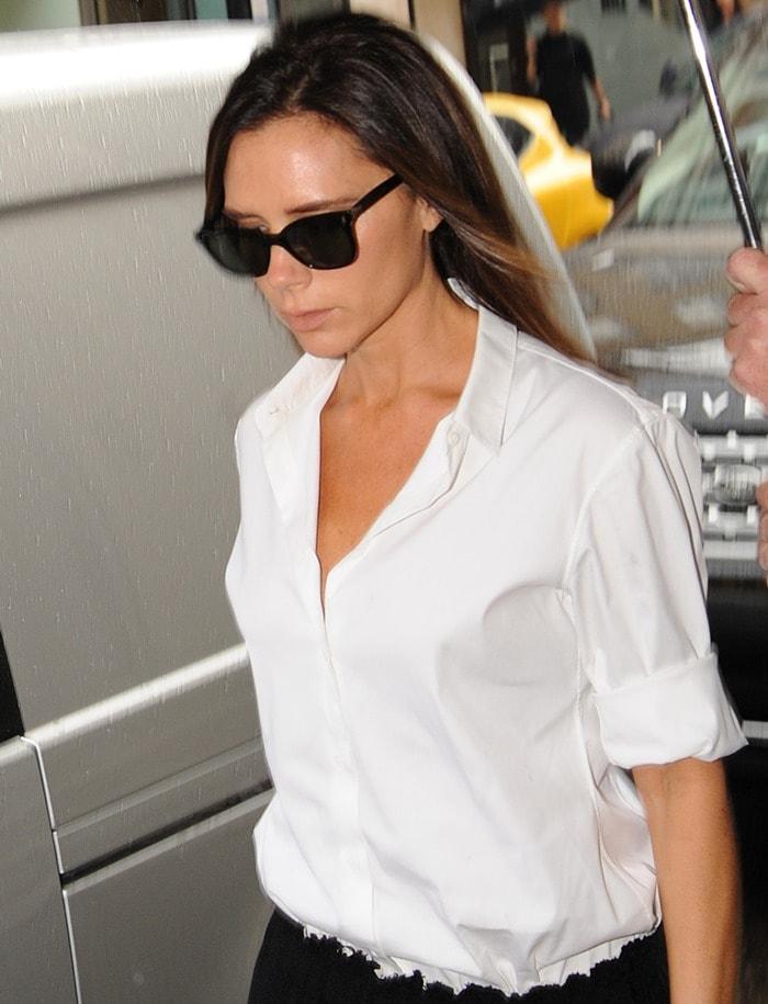 Victoria Beckham'sopen neck white shirt