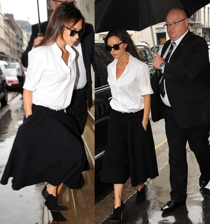 Victoria Beckham arrives at her store on Dover Street wearing a white shirt, black skirt and sunglasses