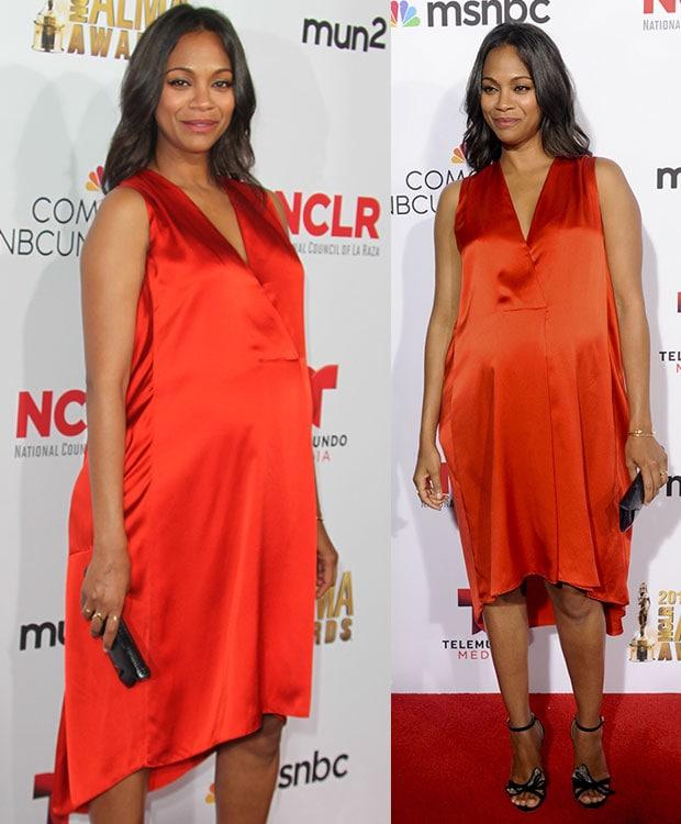 Zoe Saldana wearing a bright orange-red Narciso Rodriguez dress