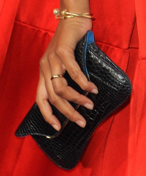 Zoe Saldana showing off her jewelry and a black clutch
