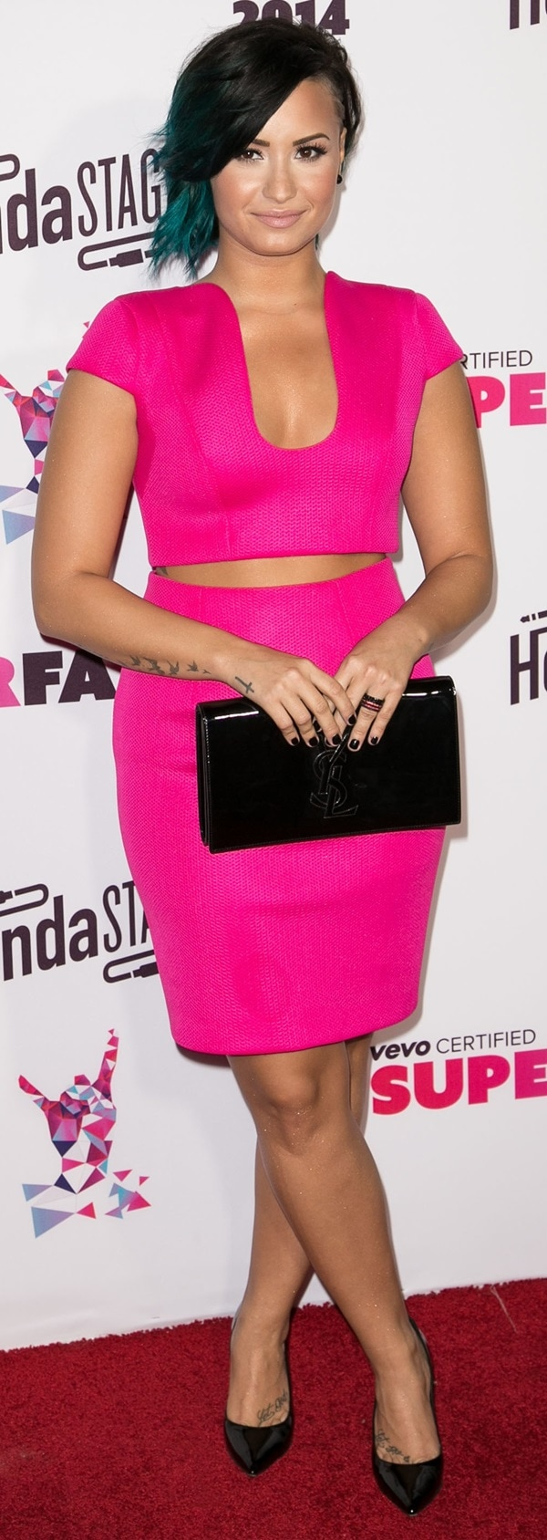 Demi Lovato showed off her toned figure in a crop top and skirt combo, exposing her midriff and cleavage