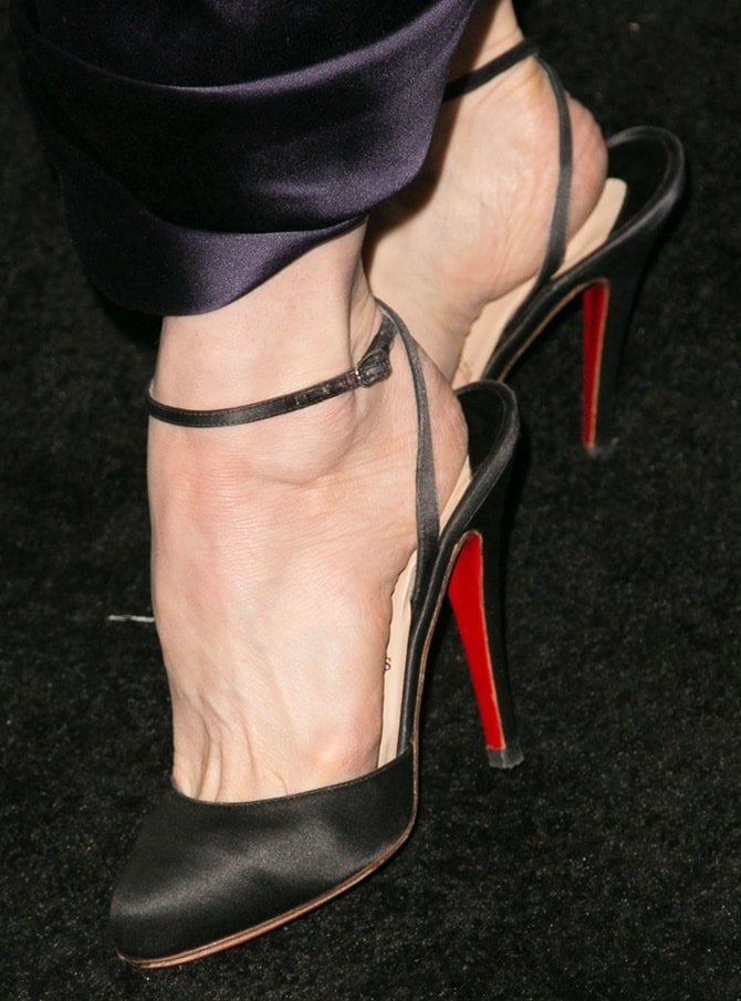 Dita Von Teese shows off her sexy feet in ankle-wrap pumps