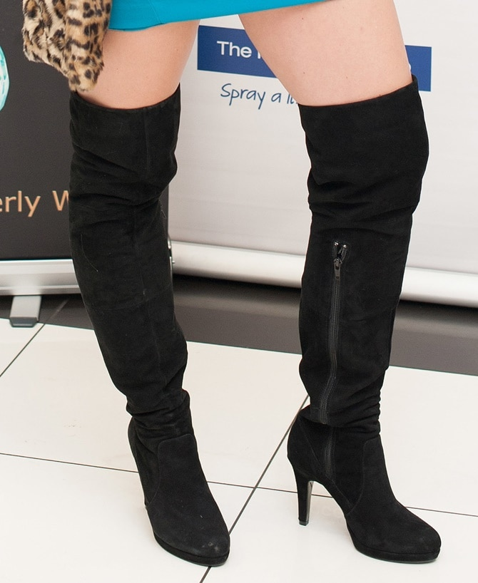 A closeup shot of Kimberly's thigh-high suede boots