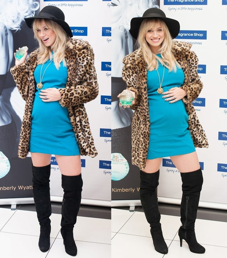 During the launch of her fragrance line at the Westfield London shopping center, the former Pussycat Dolls member rocked a glamorous ensemble consisting of a turquoise blue mini dress paired with a leopard-print coat, a floppy hat, and black thigh-high boots.