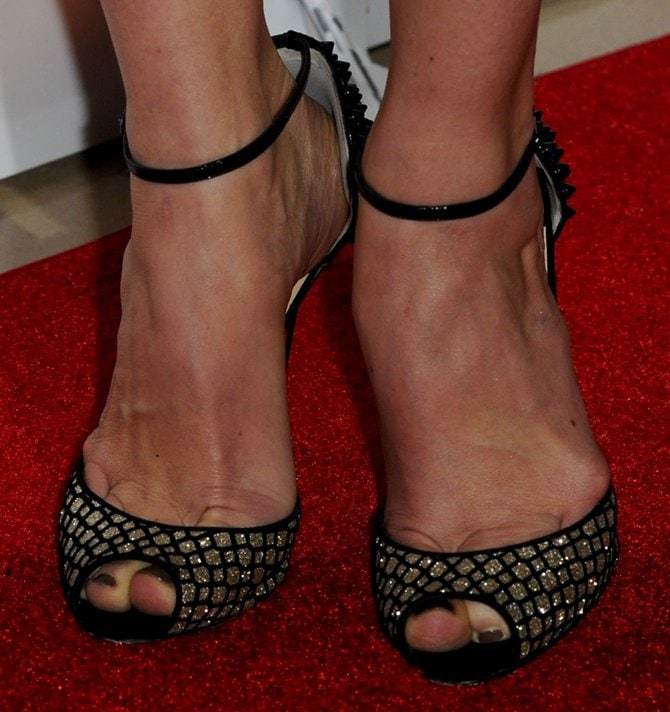 Close up shots of Michelle's 'Pina Spike' Christian Louboutin heels