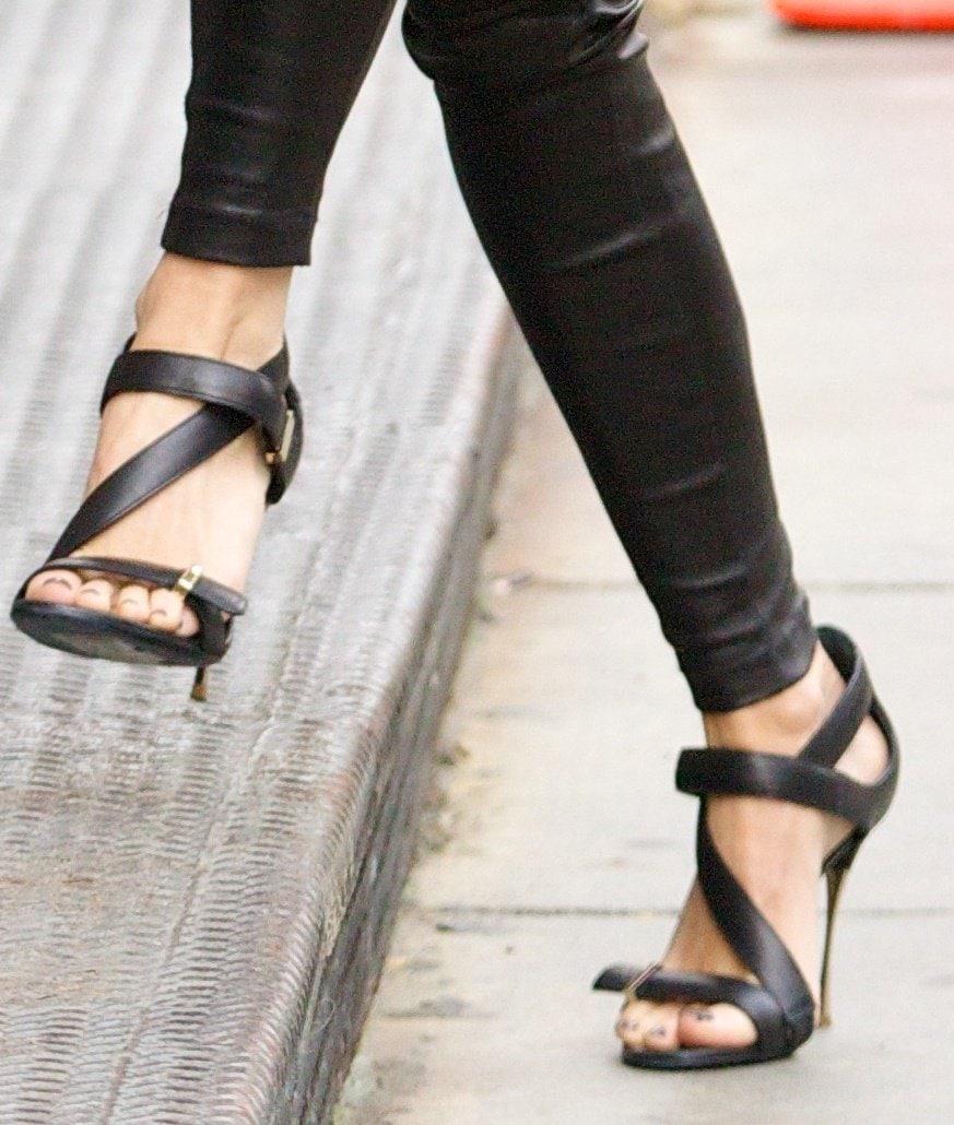 Naomi Watts wearing black strappy sandals