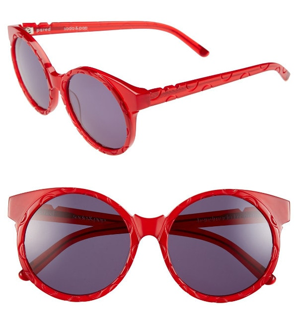 Watermelon-red Japanese acetate frames are engraved with spotty circles and paired with solid purple lenses that'll pique the paparazzi's curiosity